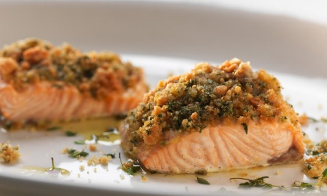 Baked salmon with cherry tomatoes and basil